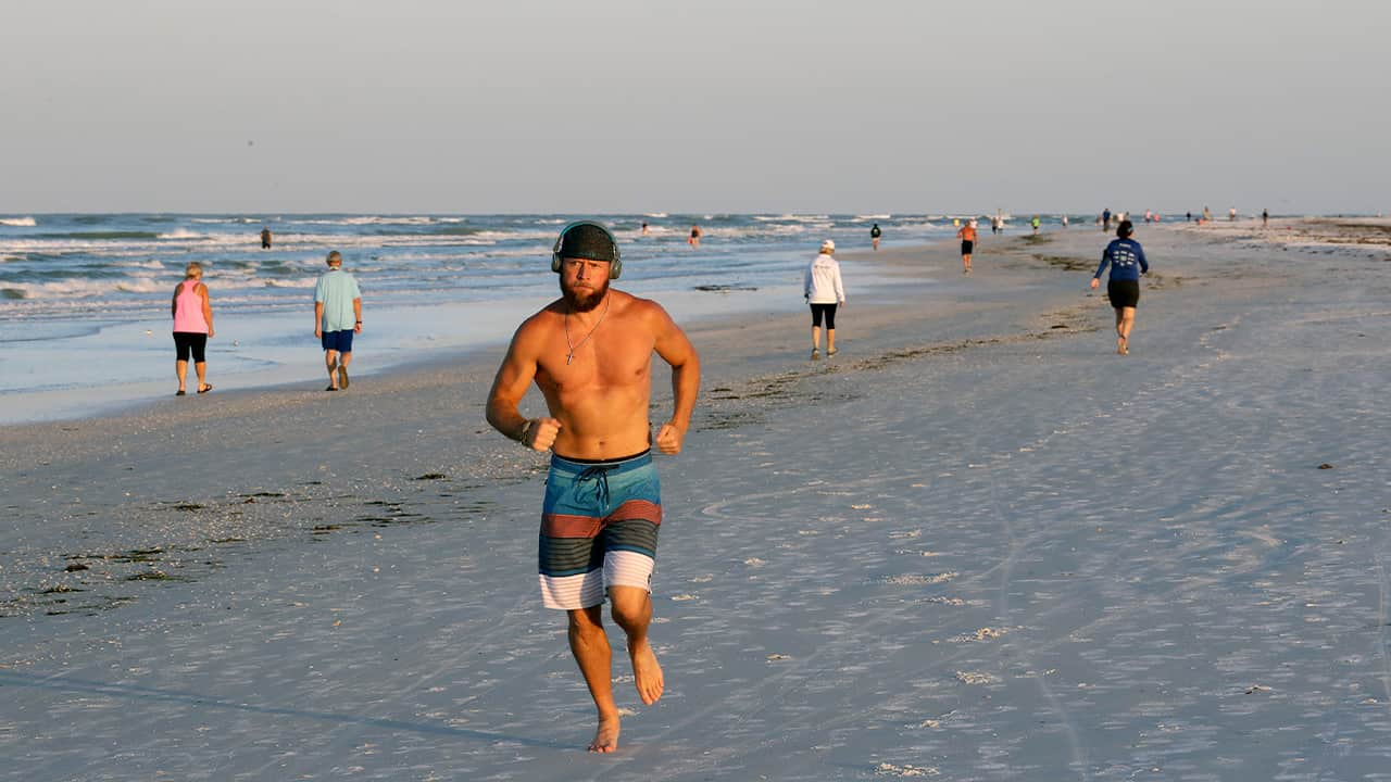 Photo of a man running on the beach in Florida