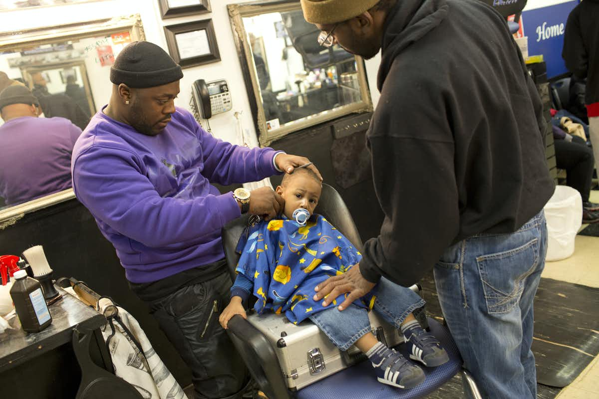 Photo of people at a barber shop