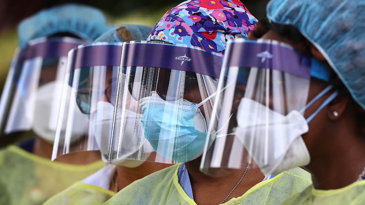 Photo of volunteers wearing face shields