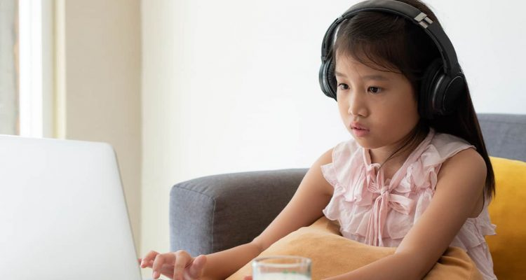 Photo of a young girl engaged in distance learning