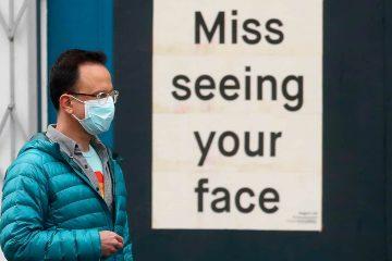 Photo of a man wearing a mask