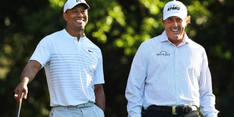 Photo of Tiger Woods, left, and Phil Mickelson