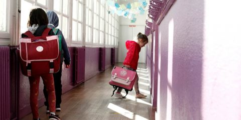 Photo of a child walking to her classroom