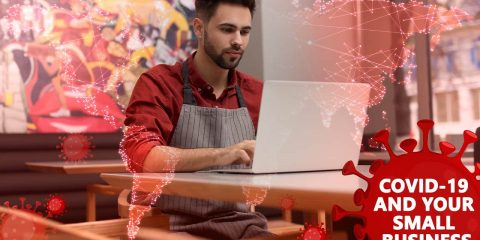 Composite image of a small businessman at laptop and COVID-19 symbols