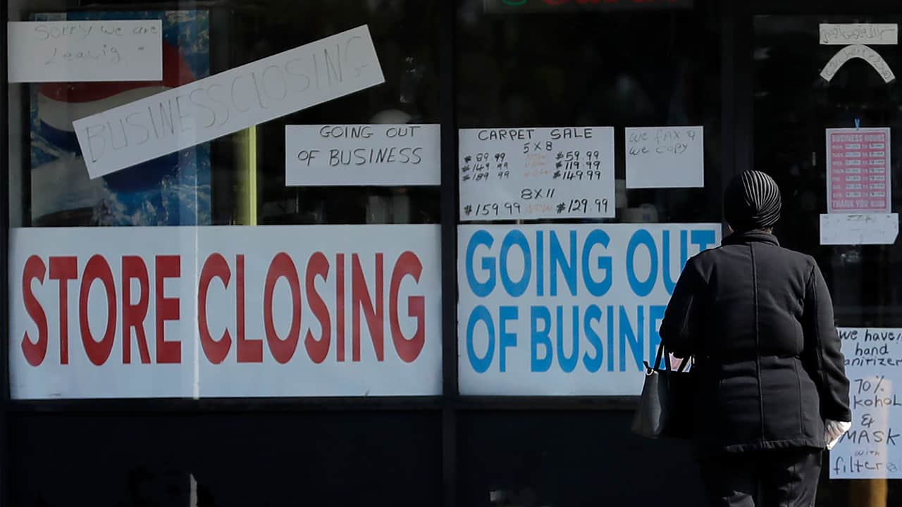 Photo of a store with closing signs on the front