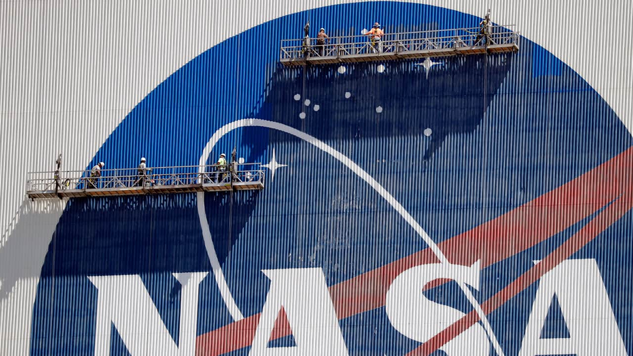 Photo of workers on a NASA building