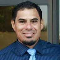 portrait of the late Justin Garza, who coached football at Central High in Fresno, California