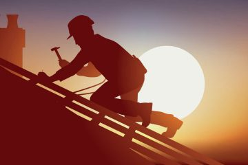 photo of a roofer working under the early evening sun