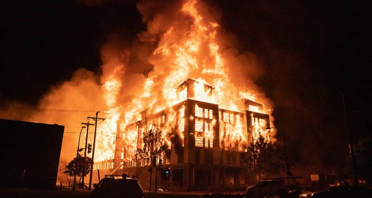 Photo of a housing complex on fire
