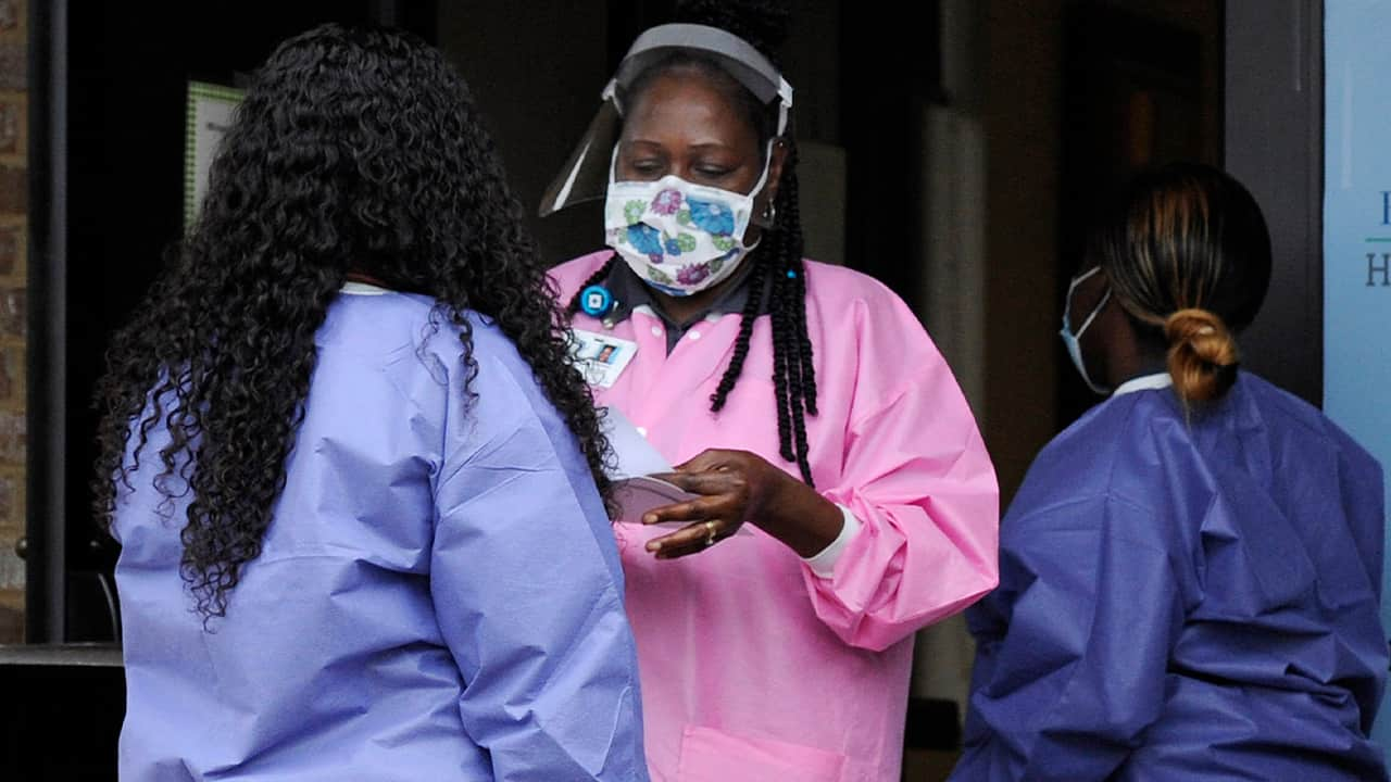 Photo of health care workers outside a Lowndes County coronavirus testing site