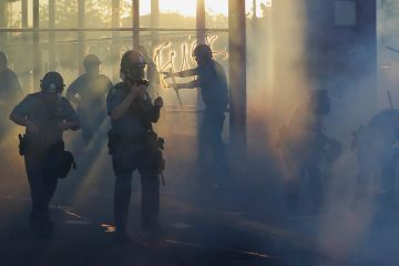 Photo of police moving through demonstrations