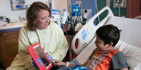 Photo of a child life team member and a Valley Children's Hospital patient