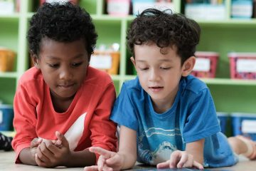 Young children in a classroom reading together