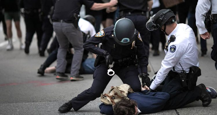 Photo of police arresting a protester in New York