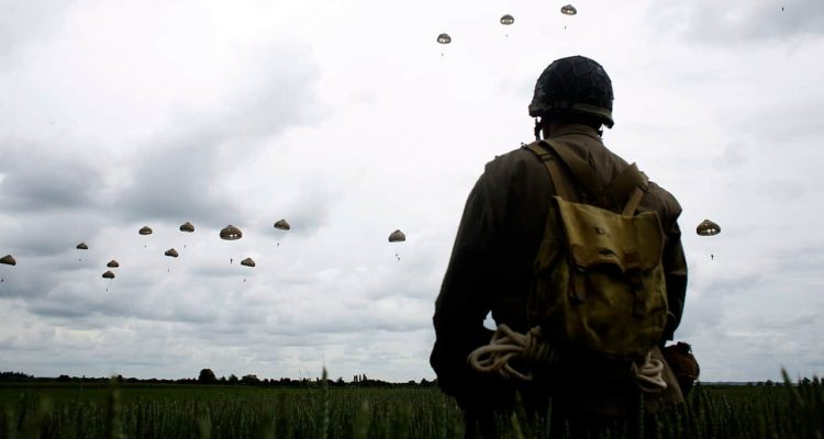 Photo of a man watching a parachute jump in France