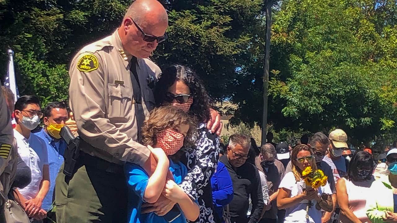 Photo of a sheriff with his wife and daughter