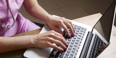 Photo of a nursing student working on a laptop