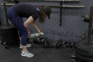 Photo of a woman cleaning weights