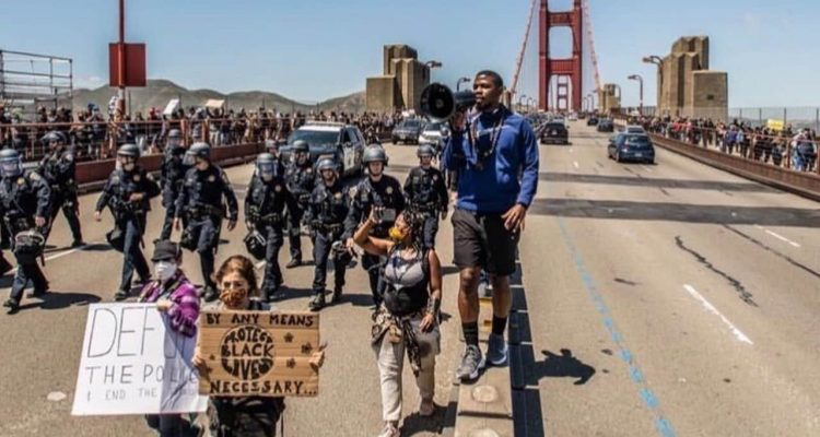 Photo of Shaheed Muhammad at a Golden Gate Bridge protest on Saturday, June 6, 2020. (Maria Dinzeo/Courthouse News Services)