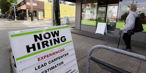 Photo of a now hiring sign