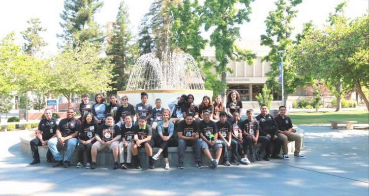 Photo of neighborhood resource officers accompanying students on a tour of Fresno State