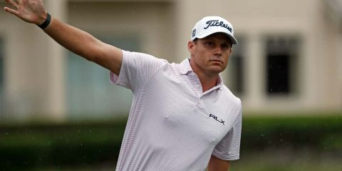 Image of PGA Tour player Nick Watney signaling after a tee shot