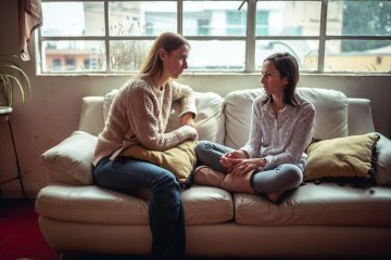 Image of a mother and child talking on a couch