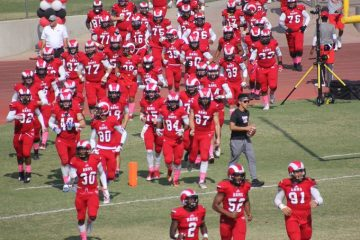 Fresno City College football team runs on to field