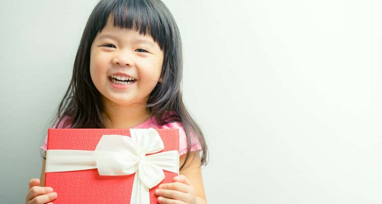 Photo of a child holding a present