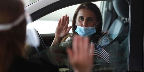 Photo of a woman during a drive-thru naturalization service