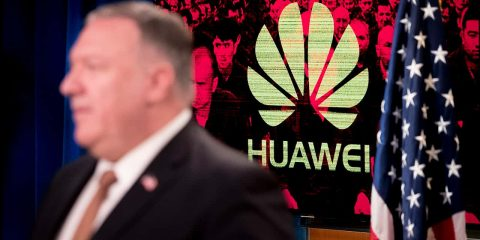 Photo of the Huawei logo and Mike Pompeo