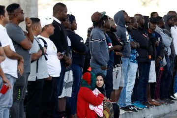 Photo of people waiting for asylum