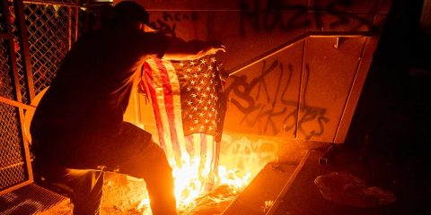Photo of a protester burning a flag