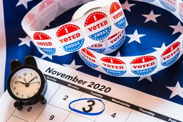 Image of calendar, an alarm clock, and I voted stickers for the November 2020 election