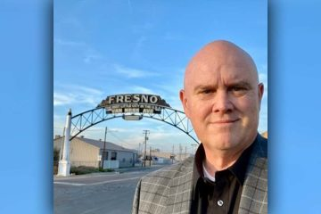 "Image of Bob Nelson in front of the ""Fresno"" sign downtownRes"