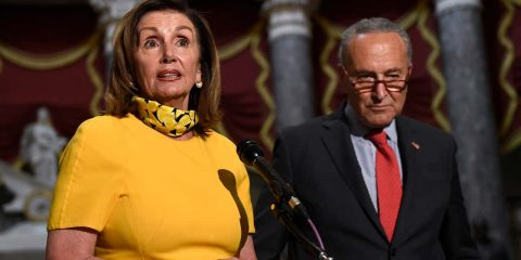 House Speaker Nancy Pelosi of Calif., left, speaks as she stands next to Senate Minority Leader Sen. Chuck Schumer
