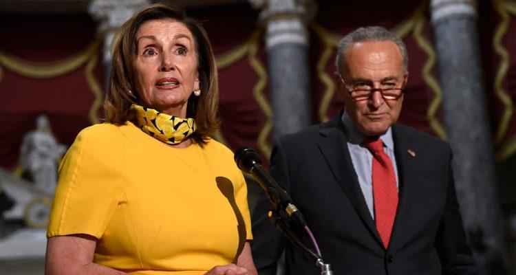 House Speaker Nancy Pelosi of Calif., left, speaks as she stands next to Senate Minority Leader Sen. Chuck Schumer