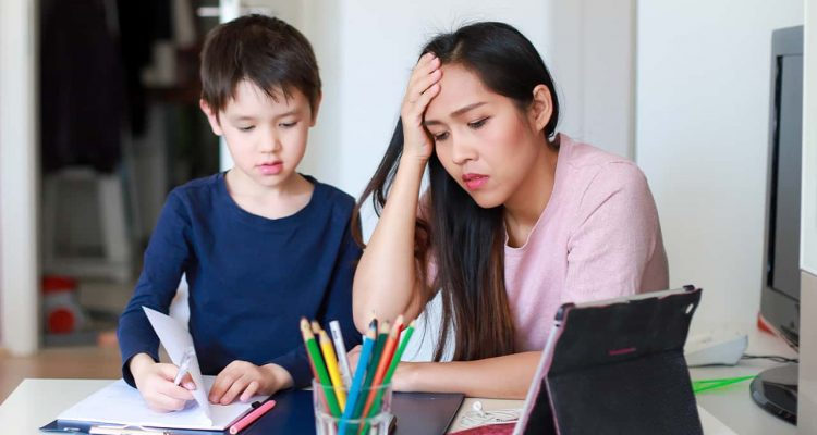 Image of a parent and child frustrated by distance online learning