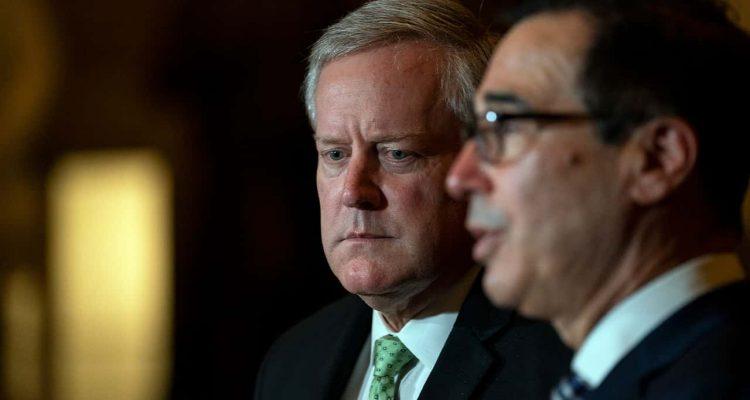 Treasury Secretary Steven Mnuchin speaks to reporters as White House chief of staff Mark Meadows