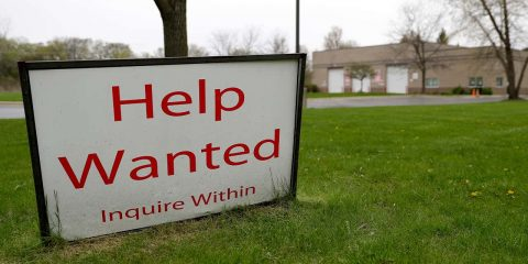 Photo of a help wanted sign