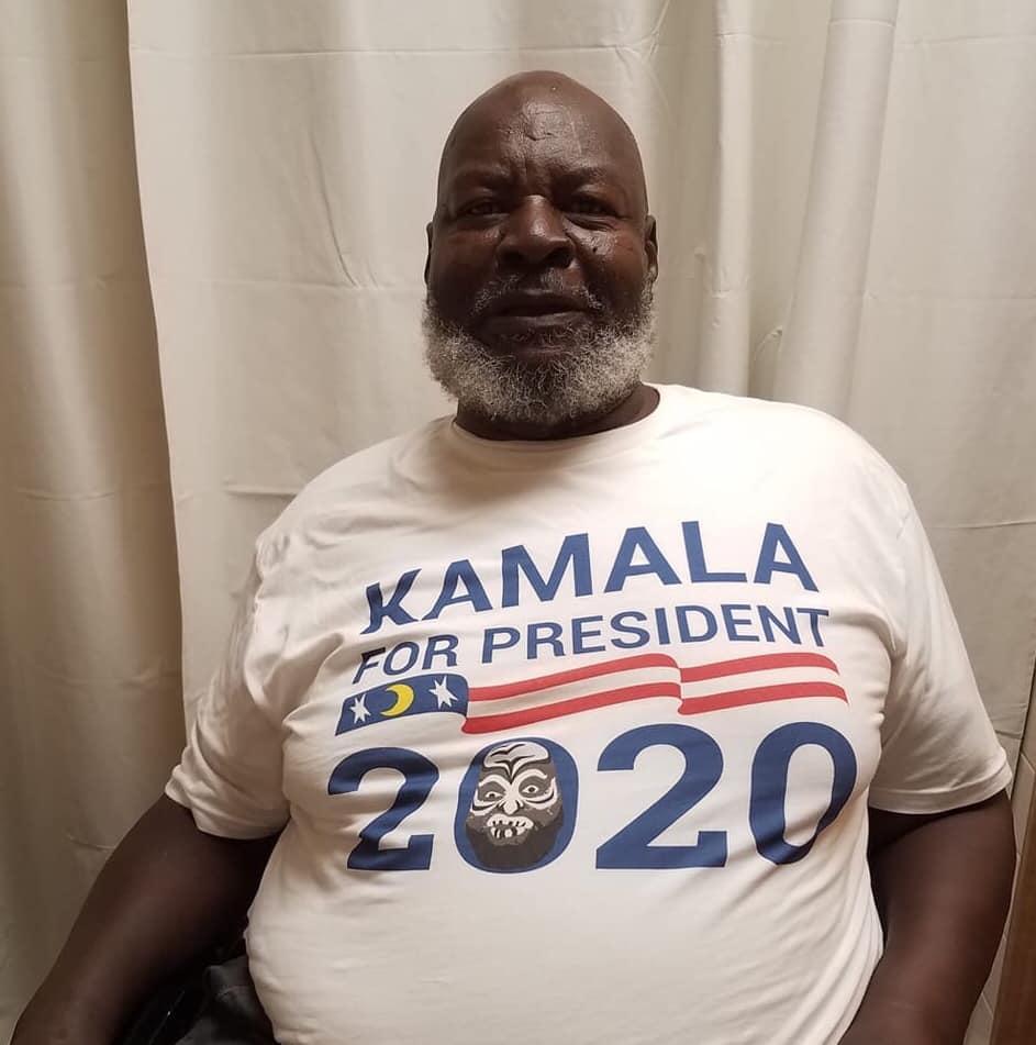"Photo of former pro wrestler James ""Kamala"" Harris wearing a Harris for President 2020 t-shirt"