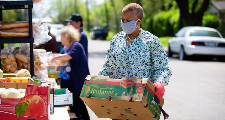 Image of people getting groceries at a food bank