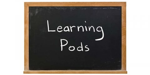 "The words ""Learning Pods"" written in white chalk on a blackboard"