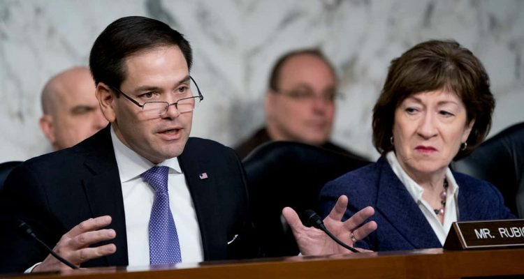 Photo of Sen. Marco Rubio, R-Fla., left, accompanied by Sen. Susan Collins, R-Maine, right