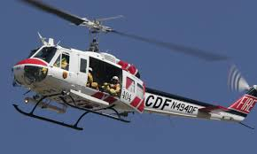 """Photo of a Bell UH-1H """"Super Huey"""" helicopter used by Cal Fire"""