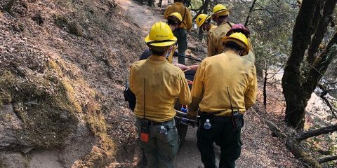Photo of a woman being carried out after falling while hiking along Willow Creek on Saturday, Aug. 22, 2020, in Madera County, California