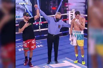 Photo of referee raising Jose Ramirez's hand in victory