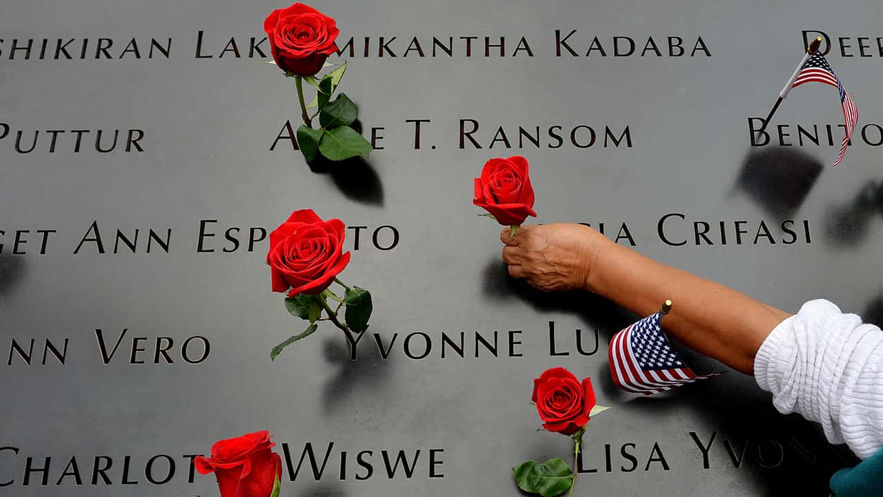 Photo of the names of 9/11 victims and roses
