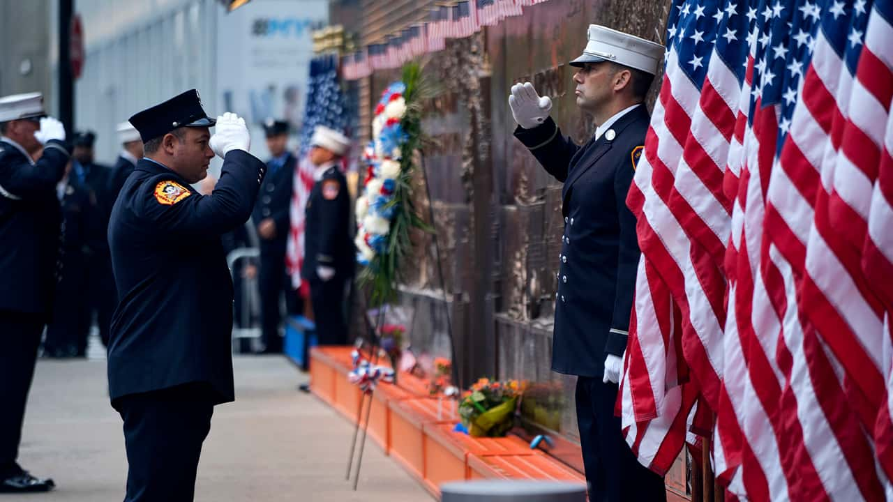 Photo of saluting New York City firefighters