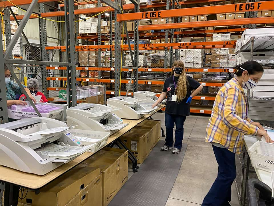 Ballots are sorted then boxed up, 250 at a time and receive a seal. (GV Wire/David Taub)